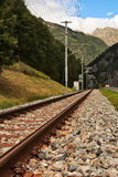 Railway tracks in mountains. Royalty Free Stock Photos