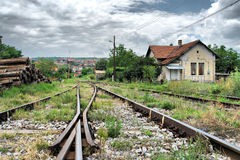 Railway tracks and an old house station Stock Images