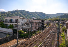 Railway tracks in residential area of Arashiyama. Railway tracks behind residential houses of Arashiyama. Western Kyoto, Japan Stock Photo