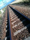 Railway tracks. Running into the distance in nature setting Royalty Free Stock Photos