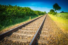 Railway tracks running to the horizon. Railway tracks running to the Blue horizon royalty free stock image