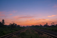 Railway tracks in a Rural with Nice Sunrise Royalty Free Stock Photos