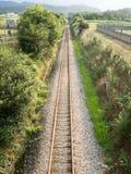 Railway tracks in a rural scene. Background Stock Photo