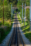 Railway tracks in a rural scene Stock Photo