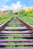 Railway tracks in a rural scene with nice blue sky.  Royalty Free Stock Photos