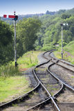 Railway tracks and signals. Railway tracks and rail signals in rural England stock photography