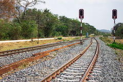 Railway tracks with signals on background of scenery Royalty Free Stock Photo