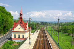 Railway tracks and small railway station Royalty Free Stock Photo
