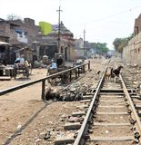 Railway tracks in a small village in india. Train is a main mode of transportation in india and it passes by all the small villages in this giant subcontinenet Stock Photos