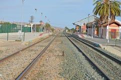 Railway - Empty Tracks And Station Royalty Free Stock Photo