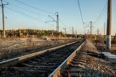 Railway tracks stretching into the distance, the prospect of autumn and the sunset at the end of the day Royalty Free Stock Photography