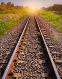 Railway tracks in sun raise moment with flair of sun Royalty Free Stock Photos