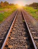 Railway tracks in sun raise moment with flair of sun Royalty Free Stock Photos
