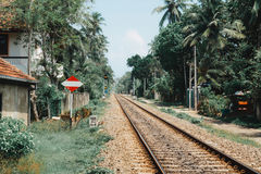 Railway tracks to the distance. Railway tracks stretch to the distance at thiranagama station, South Hikkaduwa, Sri Lanka. 16 Aug 2016 Stock Photos