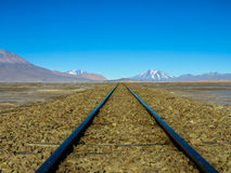 Railway tracks to nowhere. Railway tracks on a high altitude plain in Bolivia on a cold clear day Stock Photography