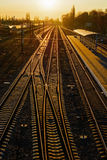 Railway Tracks at the train station at sunset. Royalty Free Stock Photo
