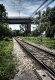 Railway. A railway tracks under a bridge Royalty Free Stock Photos