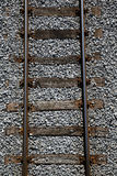 Railway tracks on a uniform background. Royalty Free Stock Photo