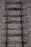 Railway tracks on a uniform background. Royalty Free Stock Photo