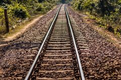 Railway tracks which shows the way for a running train royalty free stock image