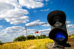 Railway traffic light. Landscape with a railway traffic light Royalty Free Stock Photos