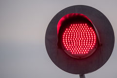 Railway traffic light. Railway red traffic light and sky background Royalty Free Stock Photo
