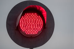 Railway traffic light. Railway red traffic light and sky background Royalty Free Stock Photos