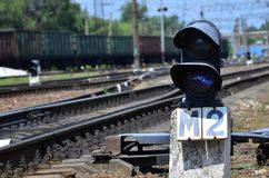 Railway traffic light semaphore against the background of a day railway landscape. Signal device on the railway trac. K royalty free stock images