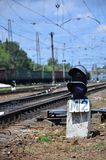 Railway traffic light semaphore against the background of a day railway landscape. Signal device on the railway trac. K royalty free stock photo