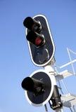 Railway traffic lights on blue sky Stock Photo