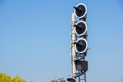 Railway traffic lights show a stop signal . Railway traffic lights show a stop signal Royalty Free Stock Photos