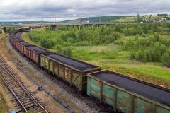 Railway train with coal follows the route Royalty Free Stock Images