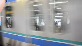 Railway train running after receive people from Nippori station. TOKYO, JAPAN - OCTOBER 19 : Railway train running after receive people from Nippori station on stock video