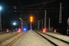 Railway and train signal at night stock image