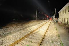Railway and train signal at night stock photos