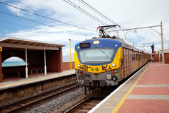 Railway train and station Stock Images