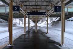 Railway. Train station in winter time Royalty Free Stock Image