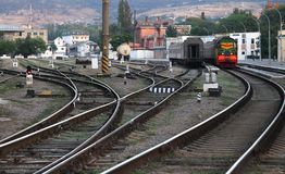 Railway and train in the town. Поезд на железной дороге в городе. royalty free stock photo