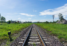 Railway train track lead to desire of the target. With blue sky background Stock Photography