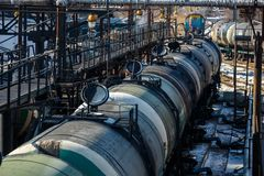Railway trains with tanks for the transport of petroleum products are on the siding stock photos