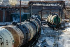 Railway trains with tanks for the transport of petroleum products are on the siding stock photography