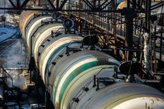 Railway trains with tanks for the transport of petroleum products are on the siding stock photo