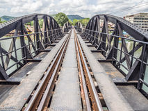 Railway trains track on metal bridge with the river and sky Royalty Free Stock Photos
