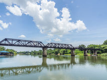 Railway trains track on metal bridge with the river and sky Stock Images