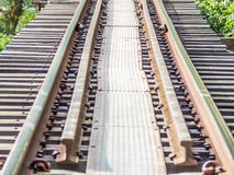 Railway trains track on wooden bridge Royalty Free Stock Images