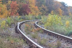 Railway or tramway track in a beautiful autumn park fog. dampness, bright warm autumn colors Stock Photography