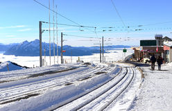 Railway or tramway track in winter with the sea of clouds backgr. Ound, Rigi Kulm, Switzerland Royalty Free Stock Photo