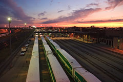 Railway transit station at sunset. Busy evening at a railroad yard Royalty Free Stock Photo