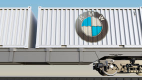 Railway transportation of containers with BMW logo. Editorial 3D rendering Royalty Free Stock Image