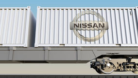Railway transportation of containers with Nissan logo. Editorial 3D rendering. Railway transportation of containers with Nissan logo. Editorial 3D Stock Photo